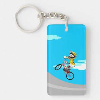 Young BMX with its bicycle raising the incline Key Ring