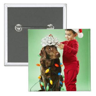 Young boy wrapping Christmas lights around a dog Pin