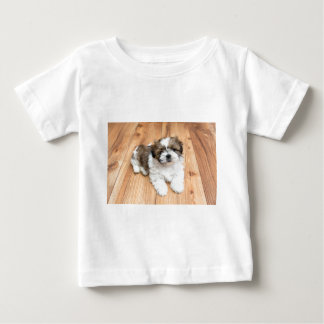 Young Chi Chu dog lying on parquet floor Baby T-Shirt