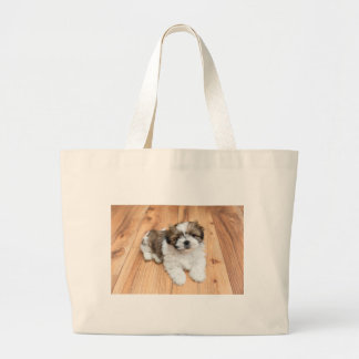Young Chi Chu dog lying on parquet floor Large Tote Bag