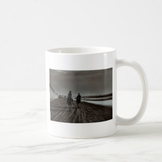 Young Couple Riding Horses at the Beach Coffee Mug