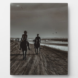 Young Couple Riding Horses at the Beach Photo Plaque