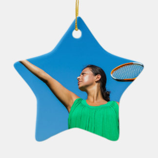 Young dutch woman with tennis racket and ball ceramic ornament