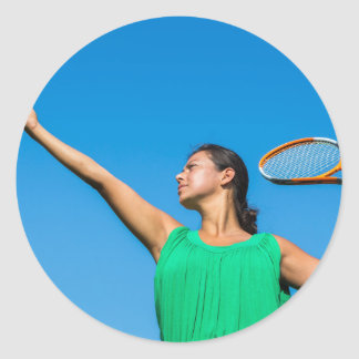 Young dutch woman with tennis racket and ball classic round sticker