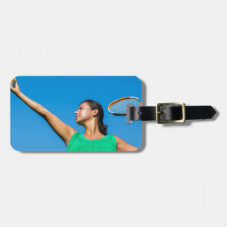 Young dutch woman with tennis racket and ball luggage tag
