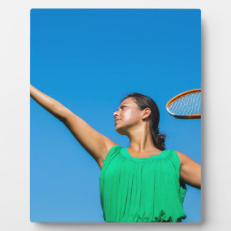 Young dutch woman with tennis racket and ball plaque