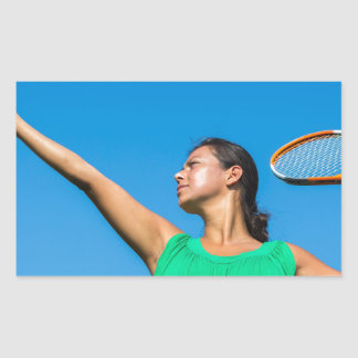 Young dutch woman with tennis racket and ball rectangular sticker
