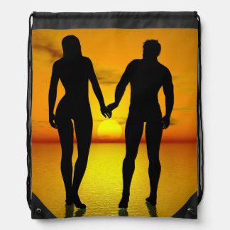 Young lovers by sunset drawstring bag