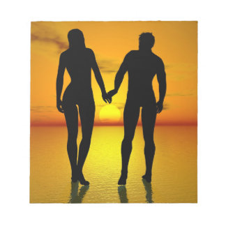 Young lovers by sunset notepad