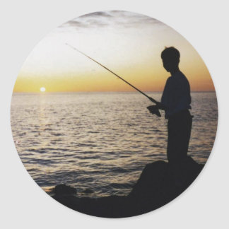 Young Man Fishing in the sunset off Anna Maria Is. Round Sticker