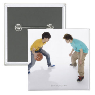 Young men playing basketball 15 cm square badge