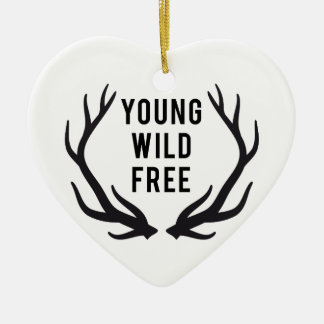 young, wild, free, text design with deer antlers ceramic ornament