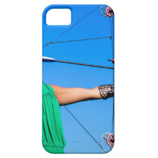 Young woman aiming arrow of compound bow iPhone 5 cases