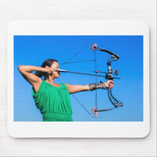 Young woman aiming arrow of compound bow mouse pad