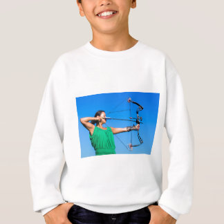 Young woman aiming arrow of compound bow sweatshirt