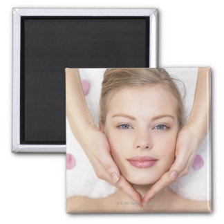 Young woman getting massage square magnet
