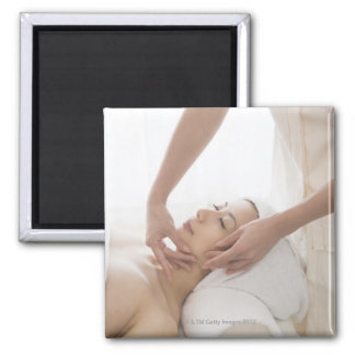 Young woman having facial massage square magnet