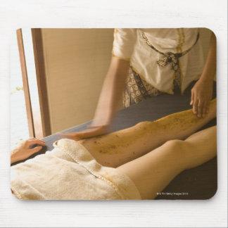 Young woman having leg massage mouse pad