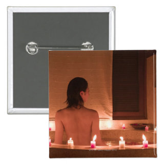 Young woman taking bath with flower petals 15 cm square badge