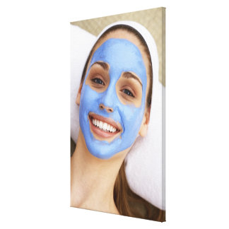 Young woman wearing facial mask, smiling, canvas prints