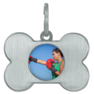 Young woman wearing red boxing gloves blue sky pet ID tag
