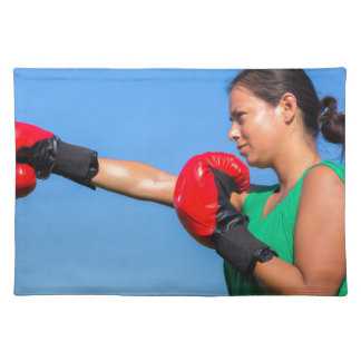 Young woman wearing red boxing gloves blue sky placemat