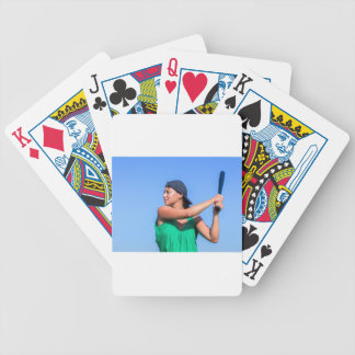 Young woman with baseball bat and cap bicycle playing cards