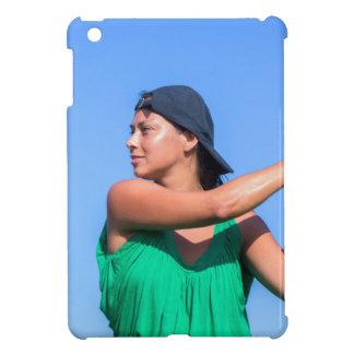 Young woman with baseball bat and cap iPad mini covers