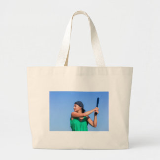 Young woman with baseball bat and cap large tote bag