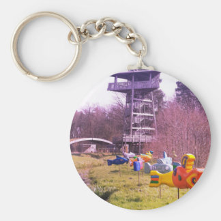 youth park wooden tower and flying wooden fishes key ring