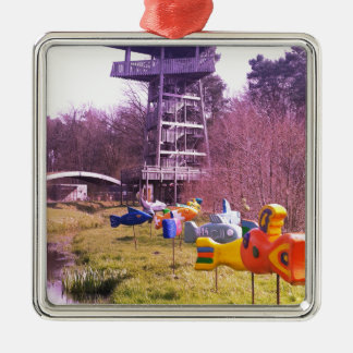 youth park wooden tower and flying wooden fishes metal ornament