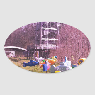 youth park wooden tower and flying wooden fishes oval sticker