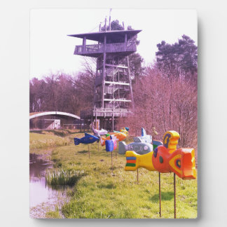 youth park wooden tower and flying wooden fishes plaque