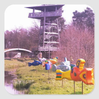 youth park wooden tower and flying wooden fishes square sticker