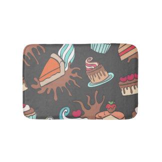 Yummy doodle cupcake pattern. bath mat