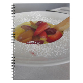 Zabaglione cream with fresh fruit and rolled wafer notebooks