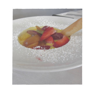 Zabaglione cream with fresh fruit and rolled wafer notepad