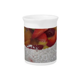 Zabaglione cream with fresh fruit and rolled wafer pitcher