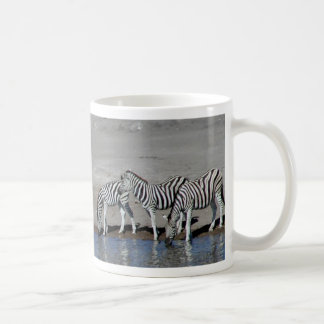 Zebras and giraffe at the local watering hole Mug